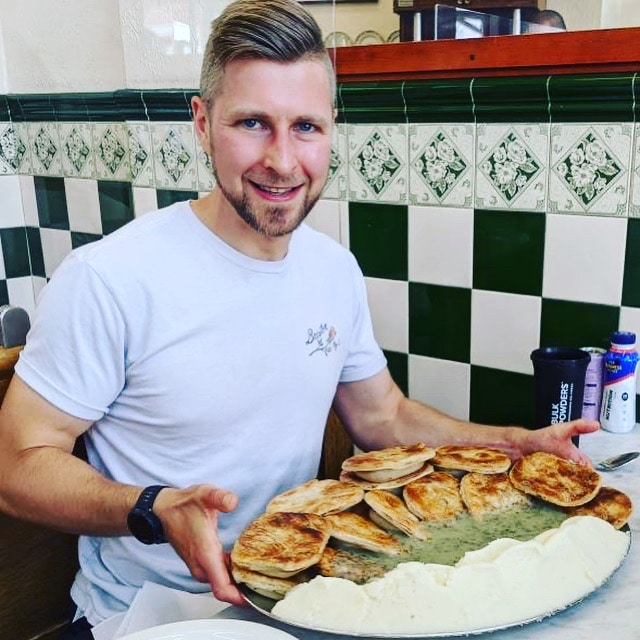 Max with his platter of pie and mash